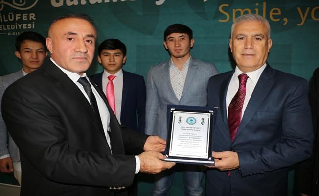 Türkiye Diyanet Vakfı'ndan Bozbey'e teşekkür plaketi